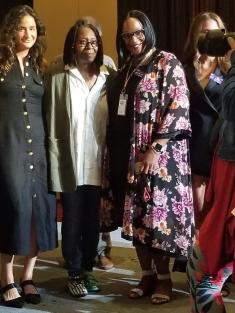 Whoopi Goldberg poises for pictures at fundraiser.
